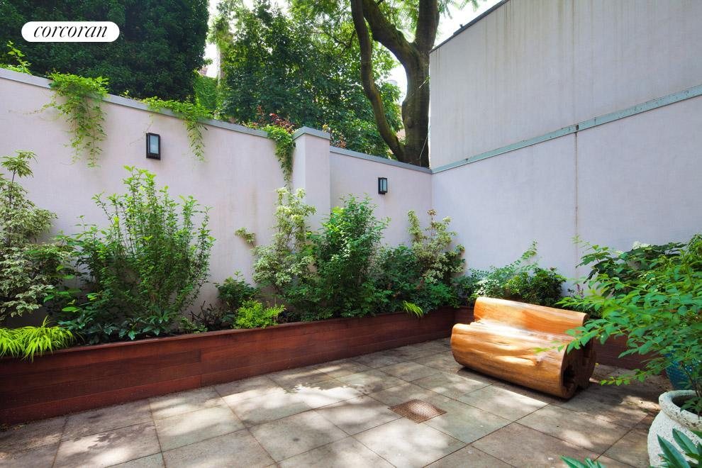 East facing landscaped garden with built in grill