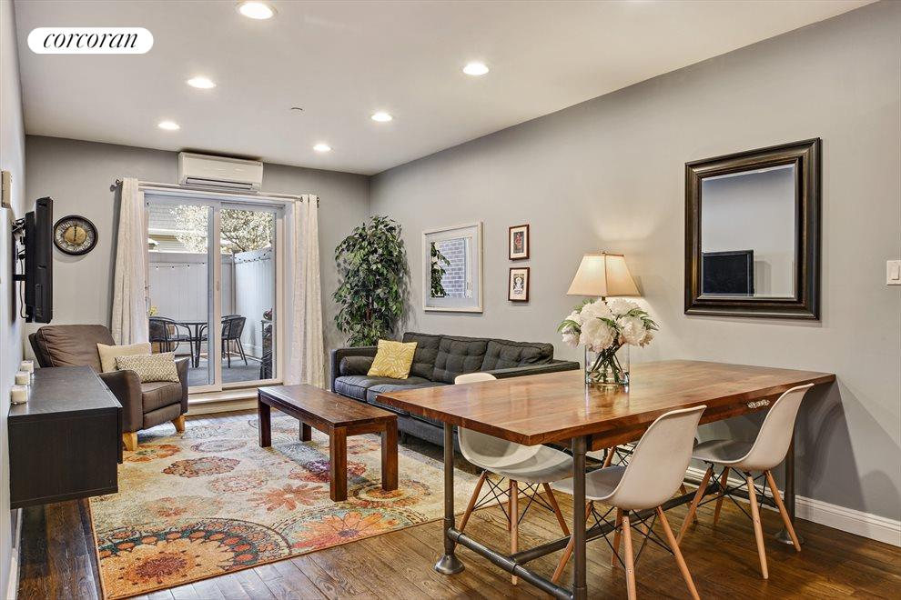 Spacious living room with access to Private Patio.