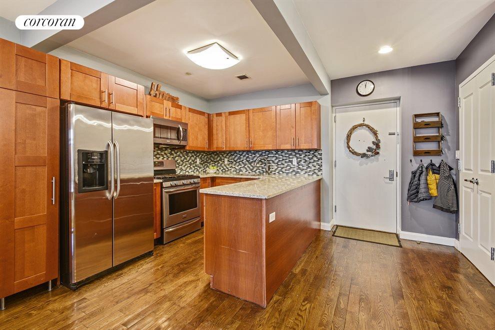 Large custom kitchen with wrap around island.