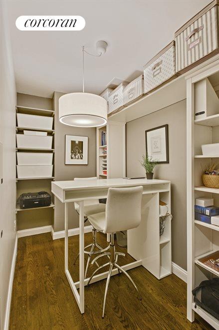 Hidden chic office with custom barn door access.