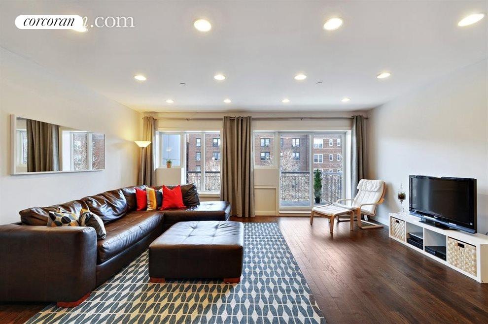 Spacious living room with access to large balcony