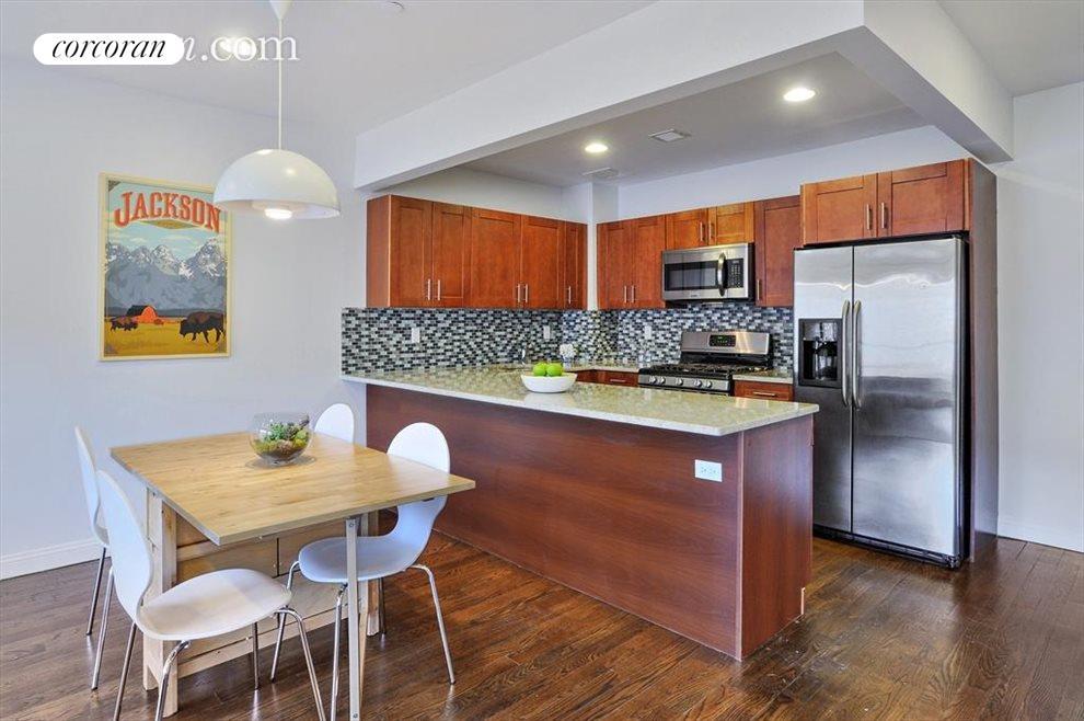 Modern kitchen with granite top wrap around island