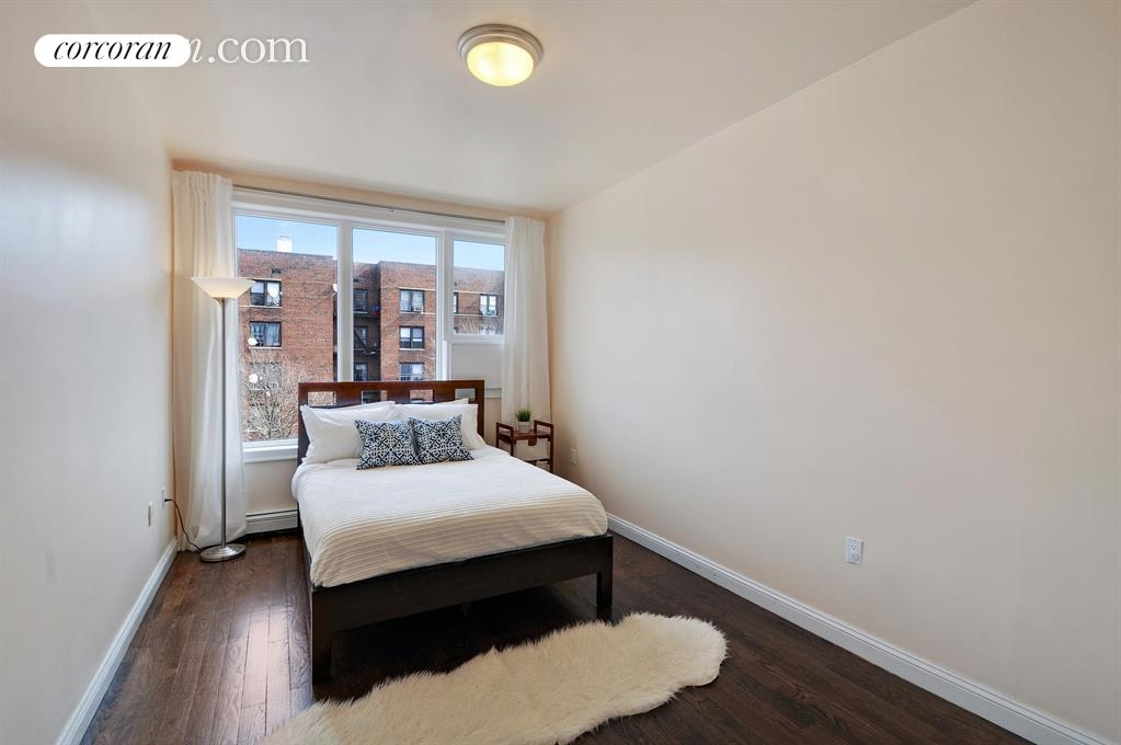 1138 Ocean Avenue, 5E, Spacious living room with access to large balcony