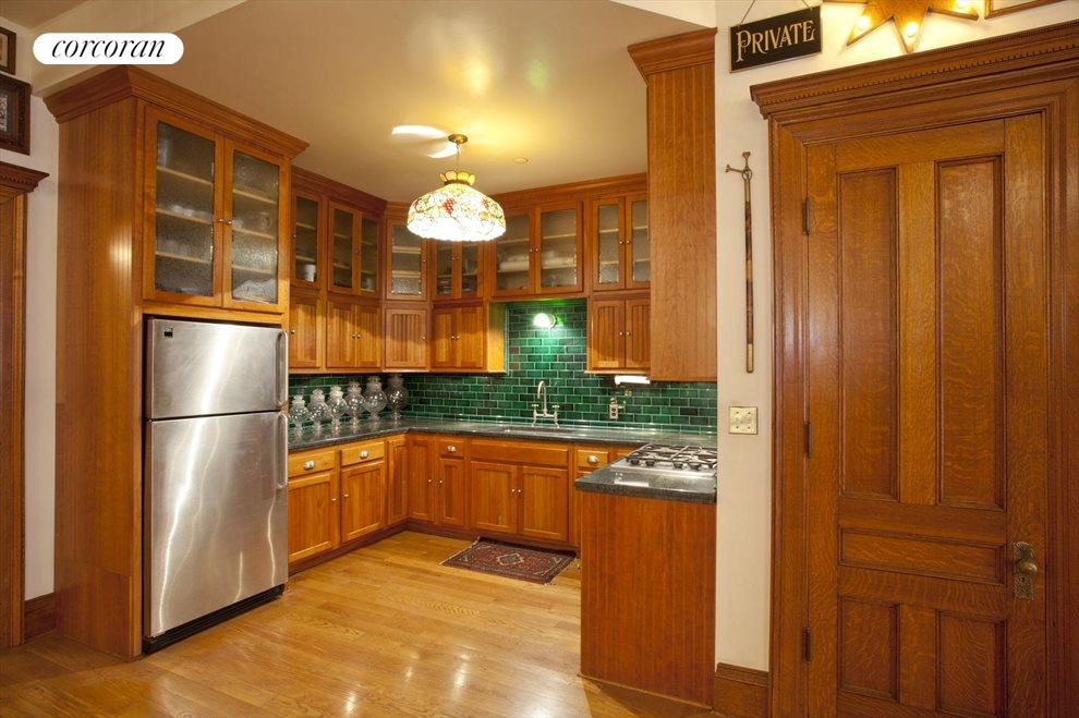 Cherrywood Cabinets with Stainless Steel Appliance
