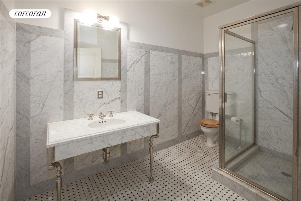 Marble Walls with Subway Tiles and Large Shower