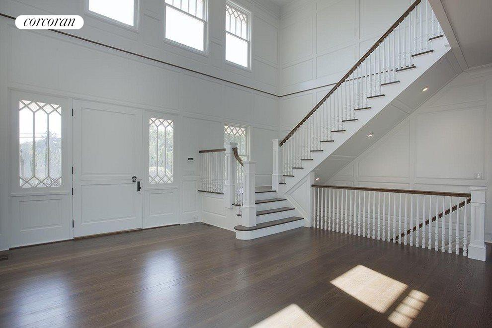 double heigh entry foyer with custom built raised paneled walls