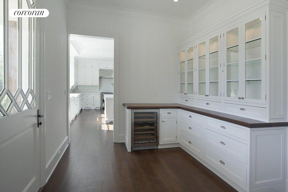 walk-in butlers pantry w/ additional food pantry
