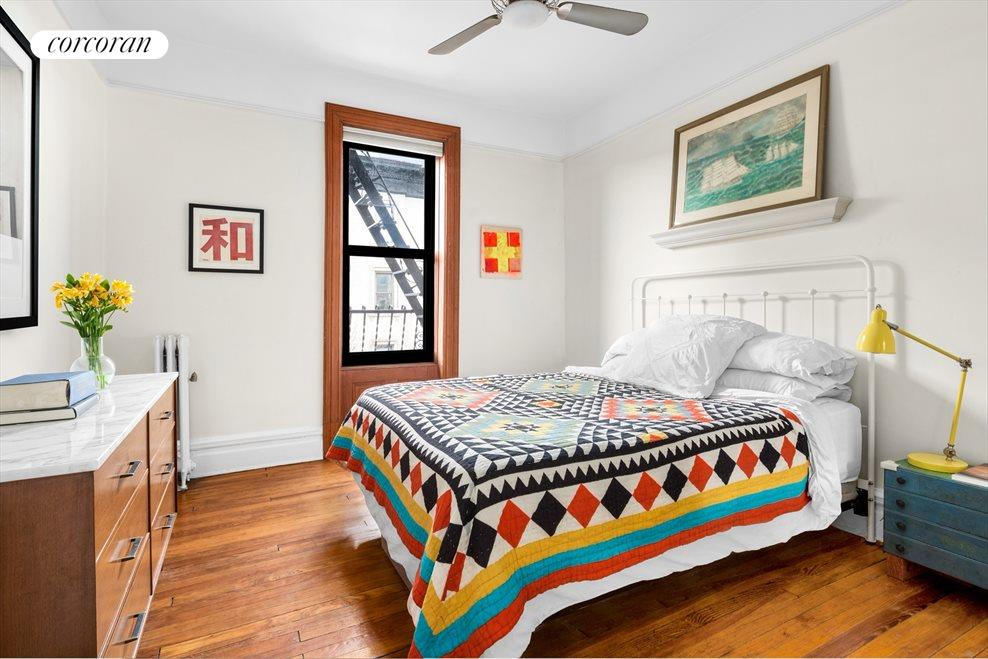Serene master bedroom with calming park breezes