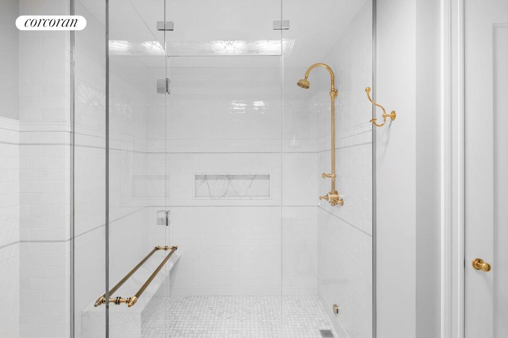 Shower room with bench, adjacent to walk in closet