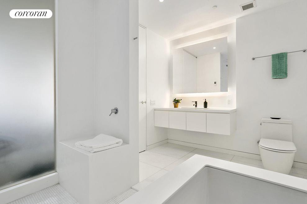 Spa bathroom w/heated floors, tub, and rain shower