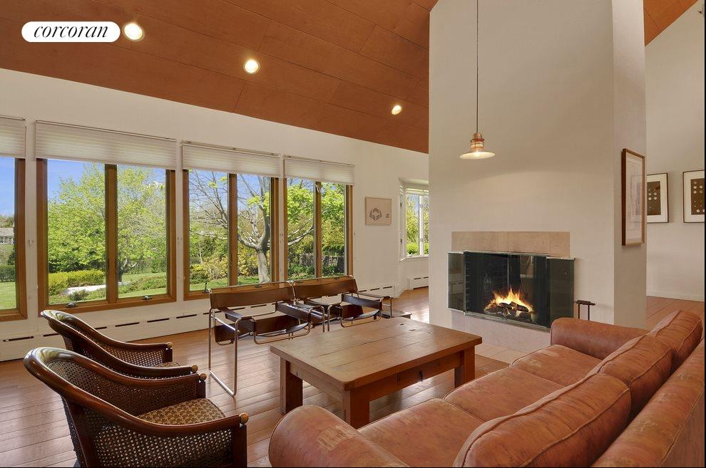 Living Room with Fireplace and wonderful view of the 2 acre property