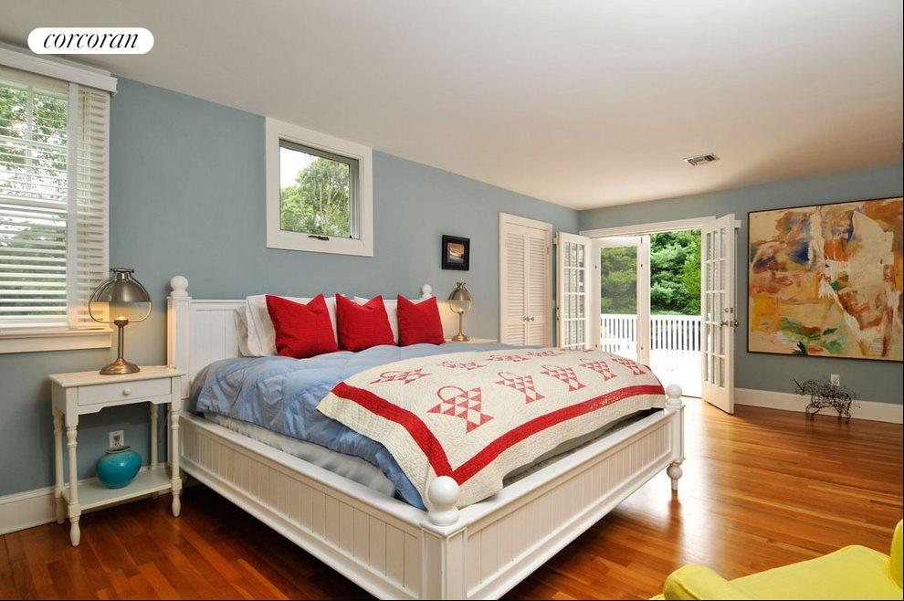 Master suite has balcony overlooking the grounds