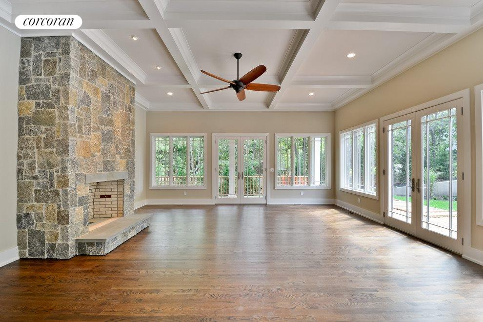 Living room with stone fireplace and french doors