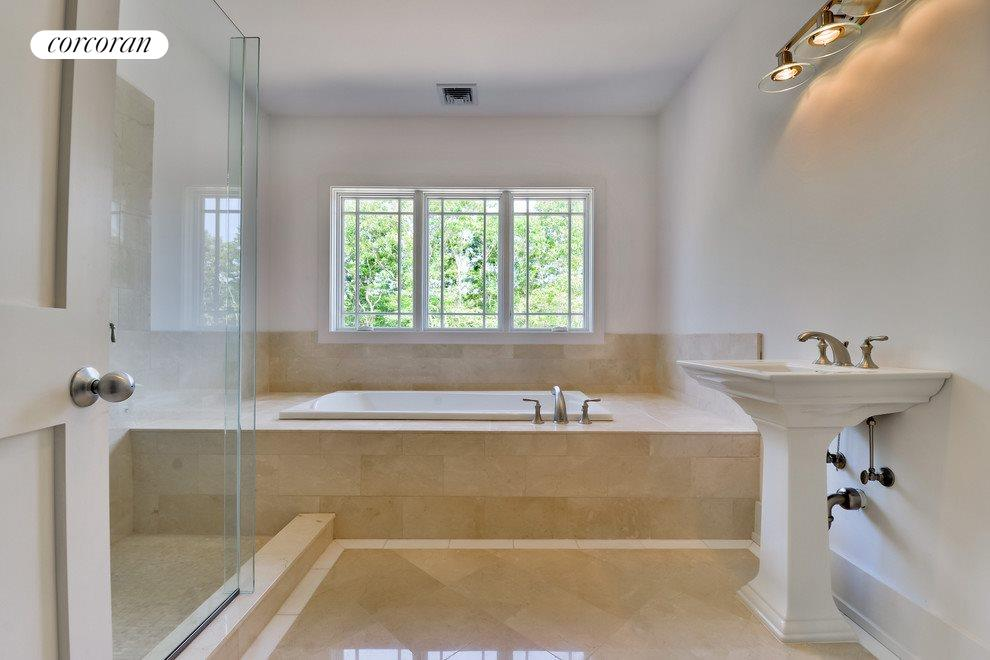 Guest bathroom with shower and jacuzzi tub