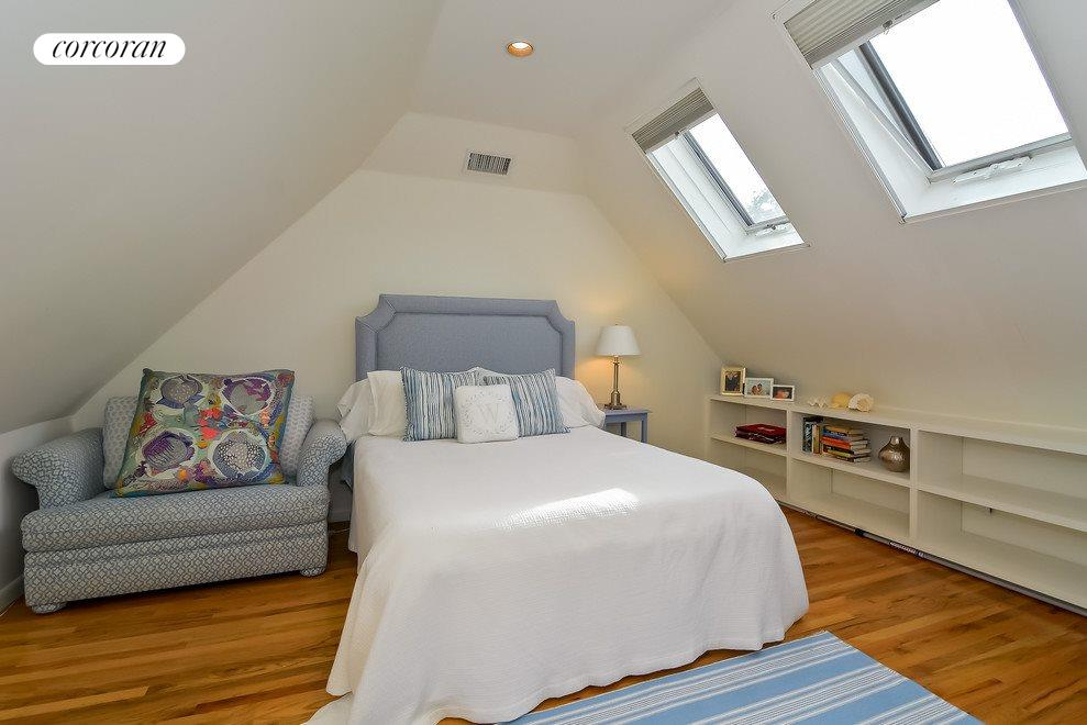 Cozy bedroom with skylights