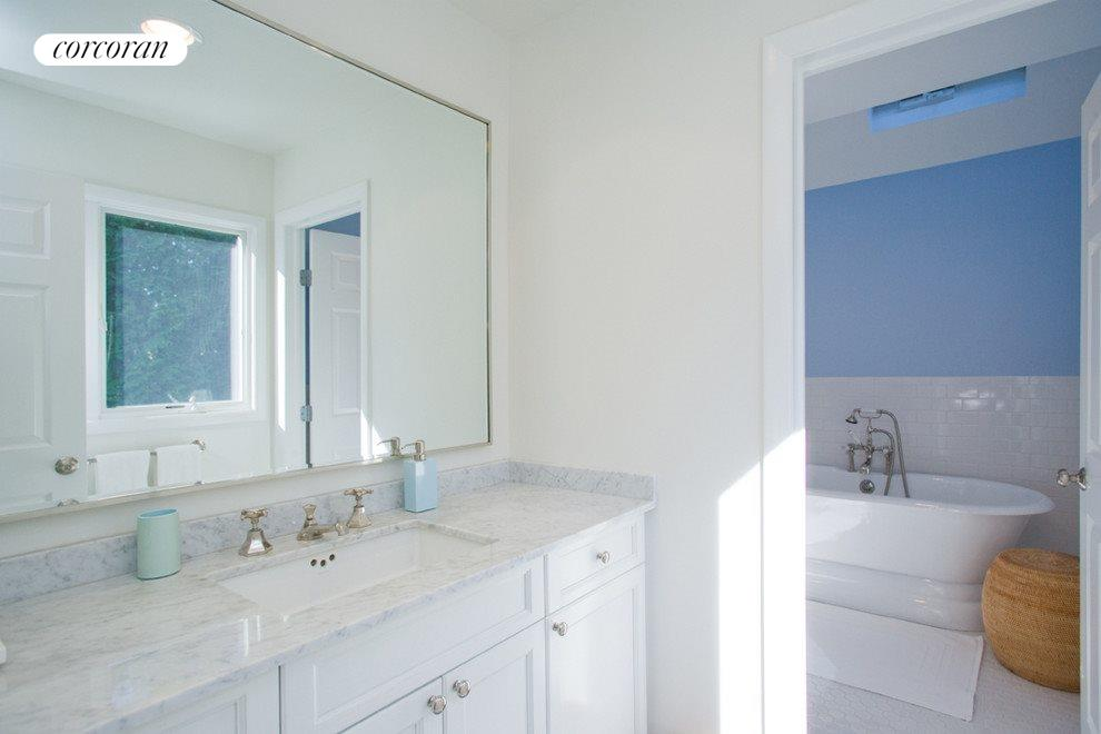 Master bathroom with jacuzzi tub and shower