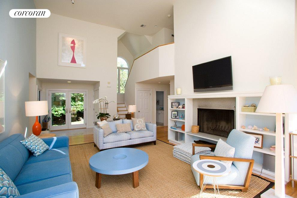 Double height living room with fireplace