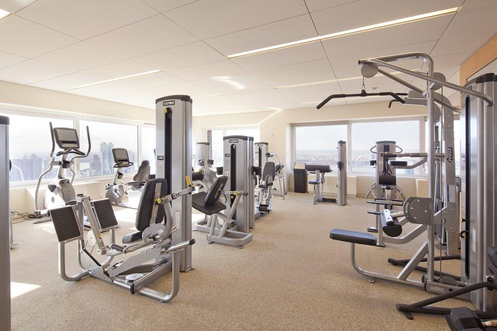 Huge complimentary gym flooded w/ natural light