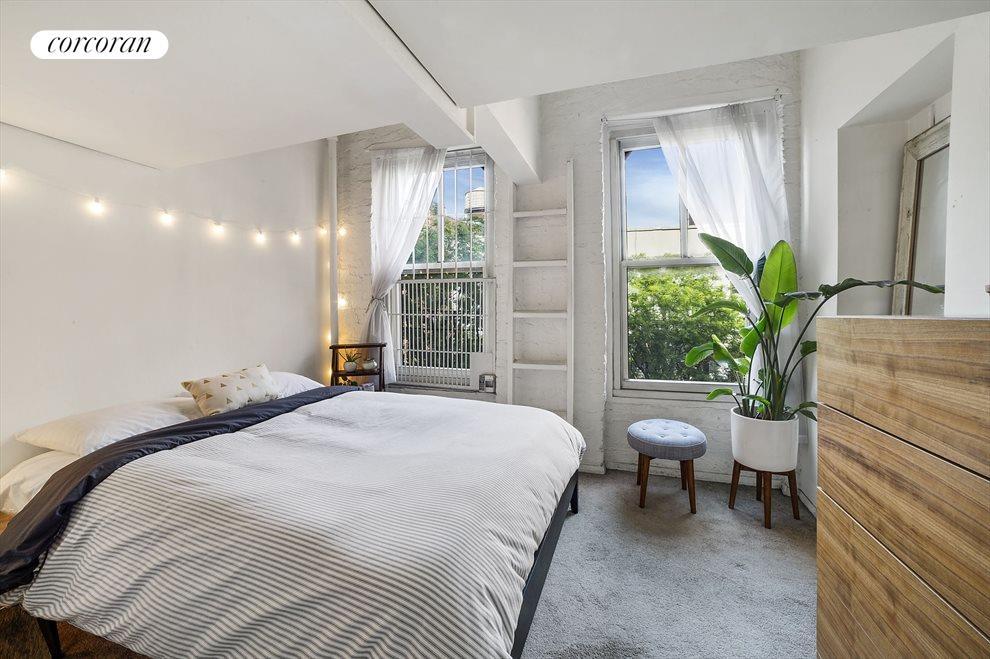 Queen sized bedroom facing west w/ 2 storage lofts
