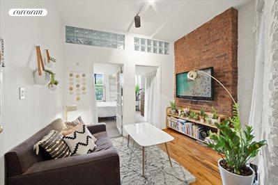 Living room with exposed brick