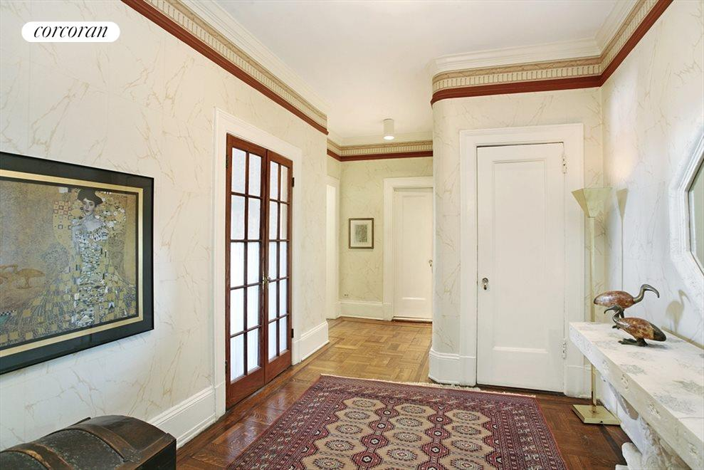 Inviting entrance foyer w/french doors to dining