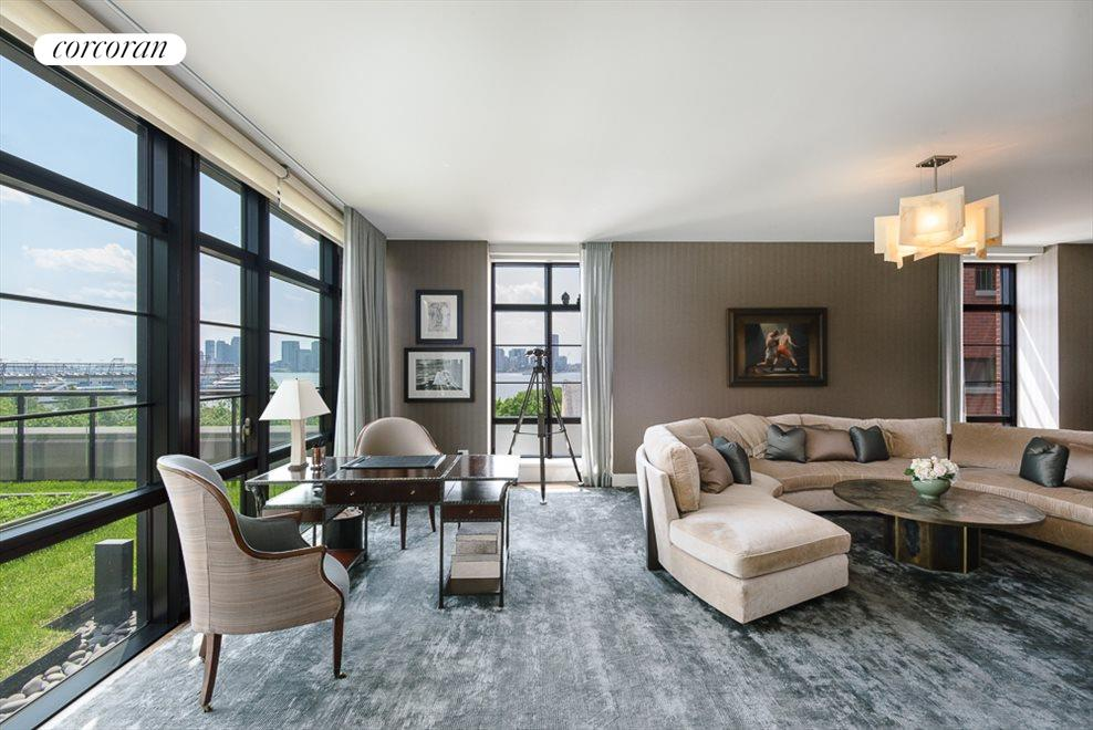 Corner Living Room with Views and Terrace Access
