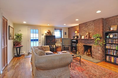 Living Room with WBFP & exposed brick wall