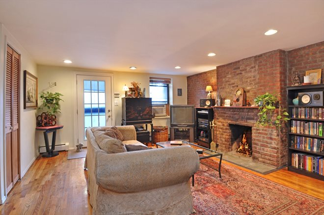 586 Pacific Street, GA, Living Room with WBFP & exposed brick wall