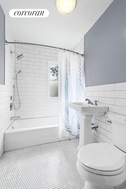 New York City Real Estate | View 541 East 38th Street | Renovated Bathroom