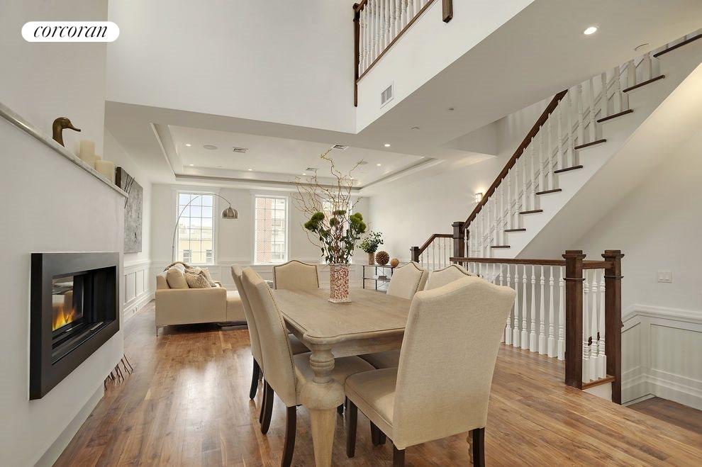 Dining Room w/ Double Height Ceiling & Fireplace