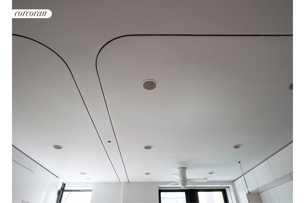 Curtain track in ceiling