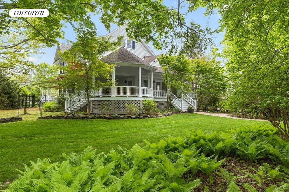 Ample covered porches and generous rear yard with room for pool