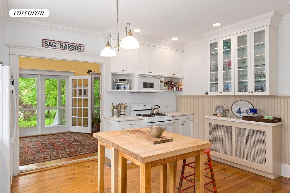 Large kitchen opens to sunroom