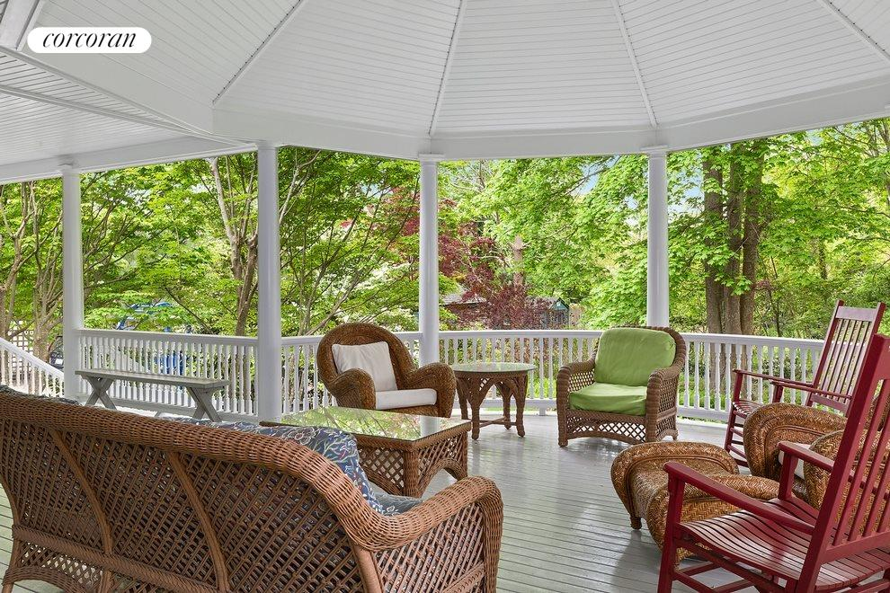 Relax awhile on this beautiful covered porch
