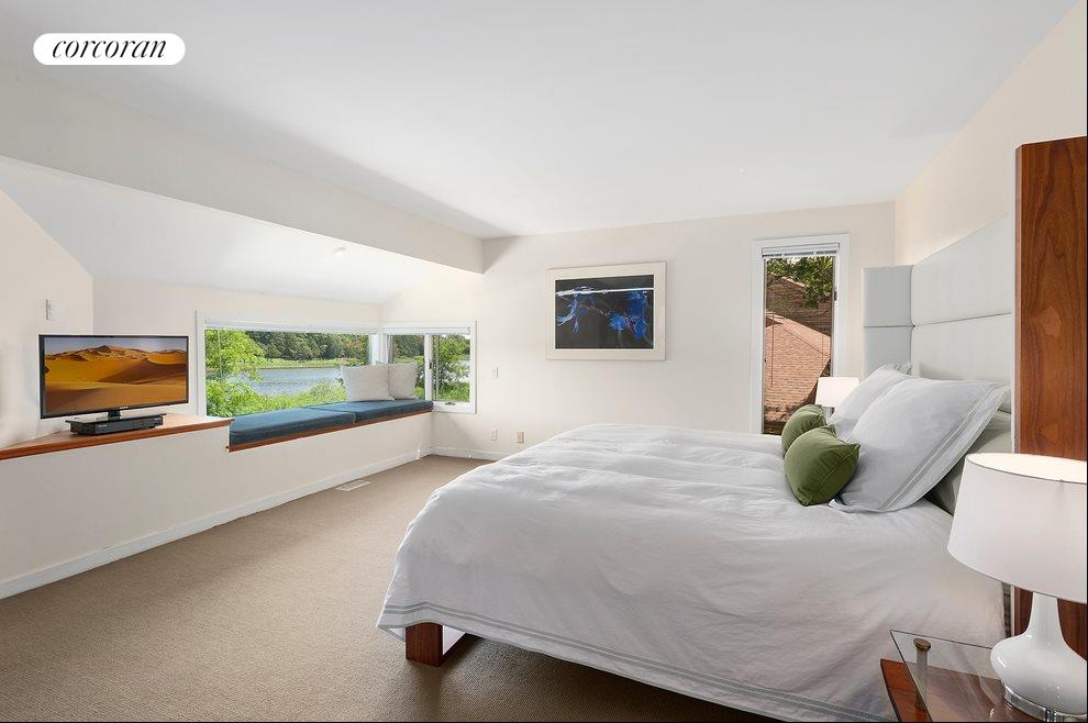 Master Suite with Sitting area overlooking the pond