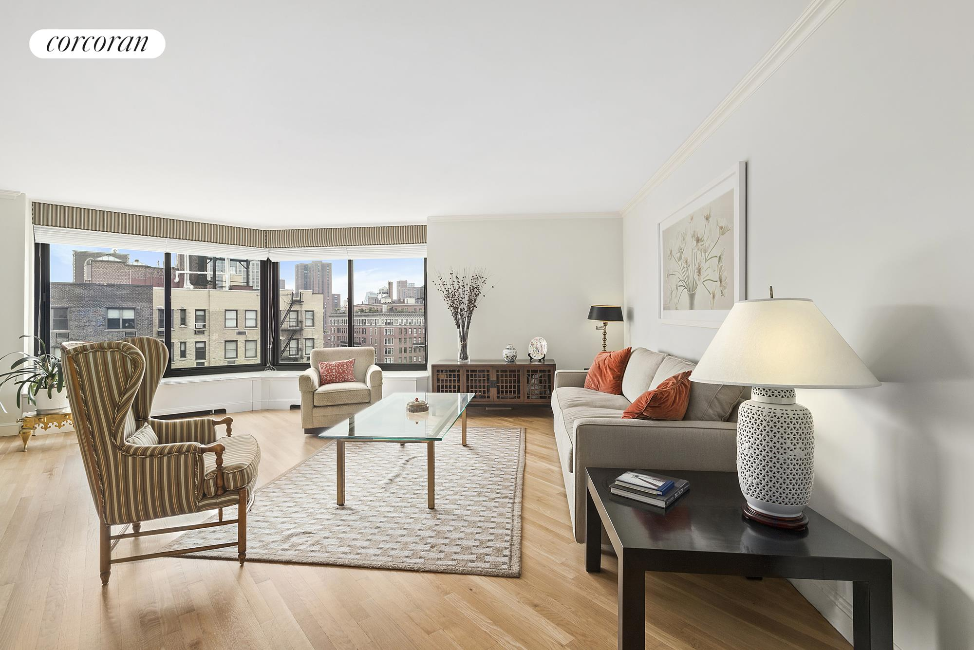 40 East 94th Street, 17G, Big windows wrap the living and dining areas.