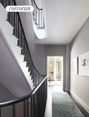 New York City Real Estate | View 141 West 11th Street | Oval staircase with sky-light above