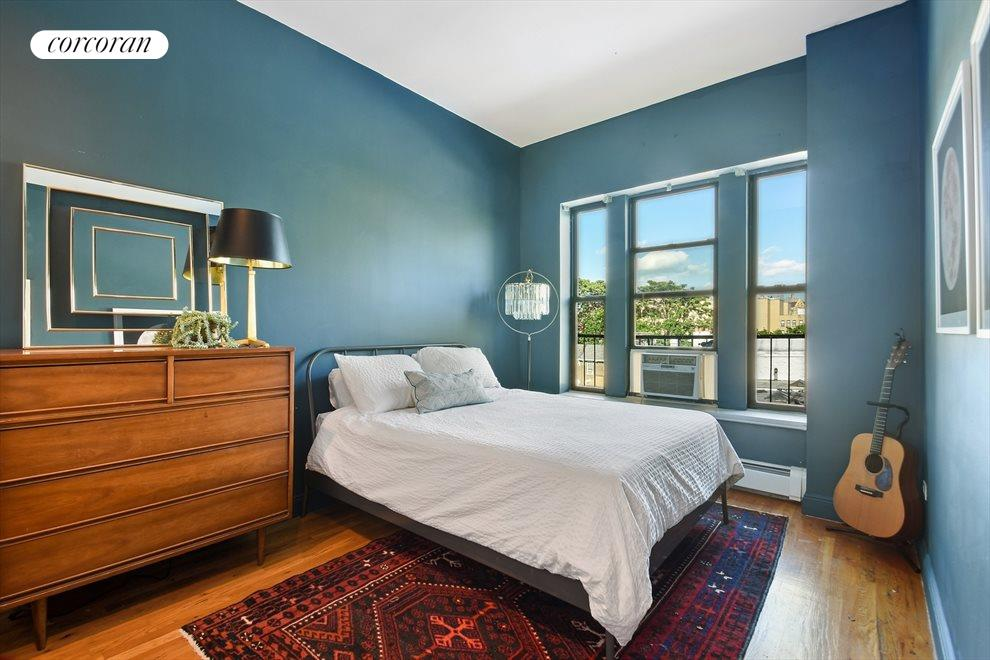Spacious master bedroom with extra large windows