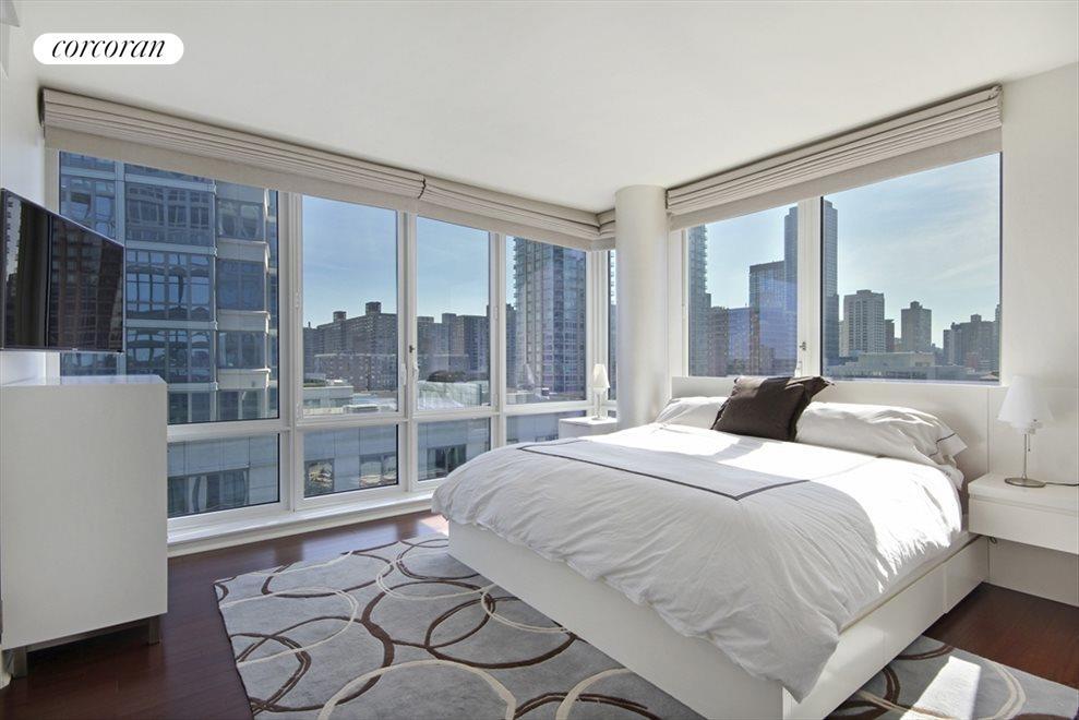Corner Master Suite with Walls of Windows