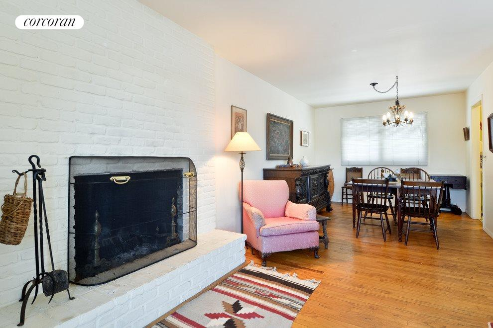 Cozy fireplace and wood floors