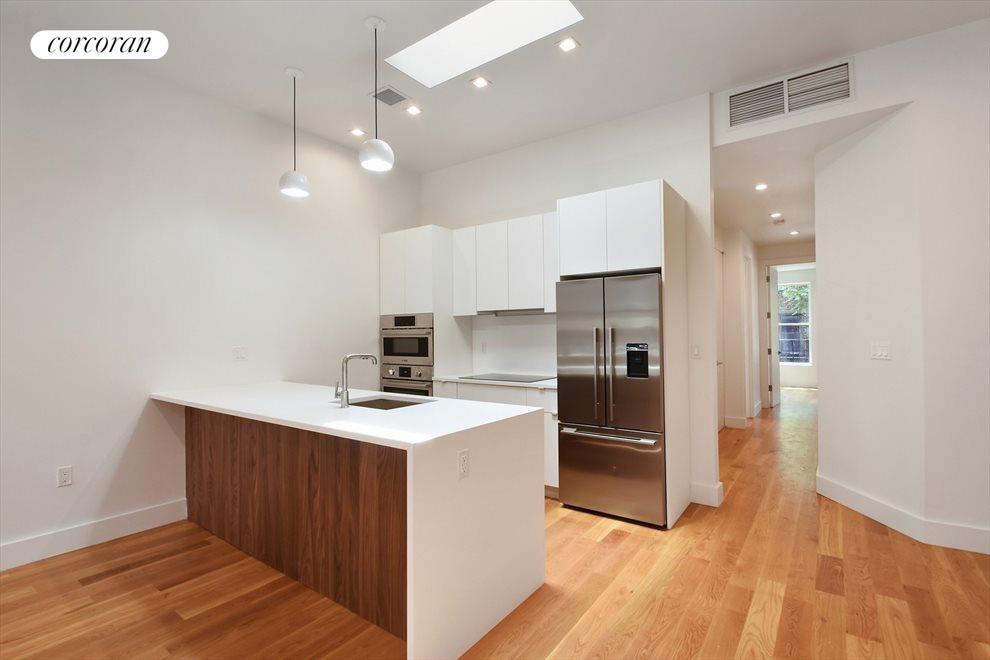 Open Kitchen w/ Quartz counters, Bosch Appliances