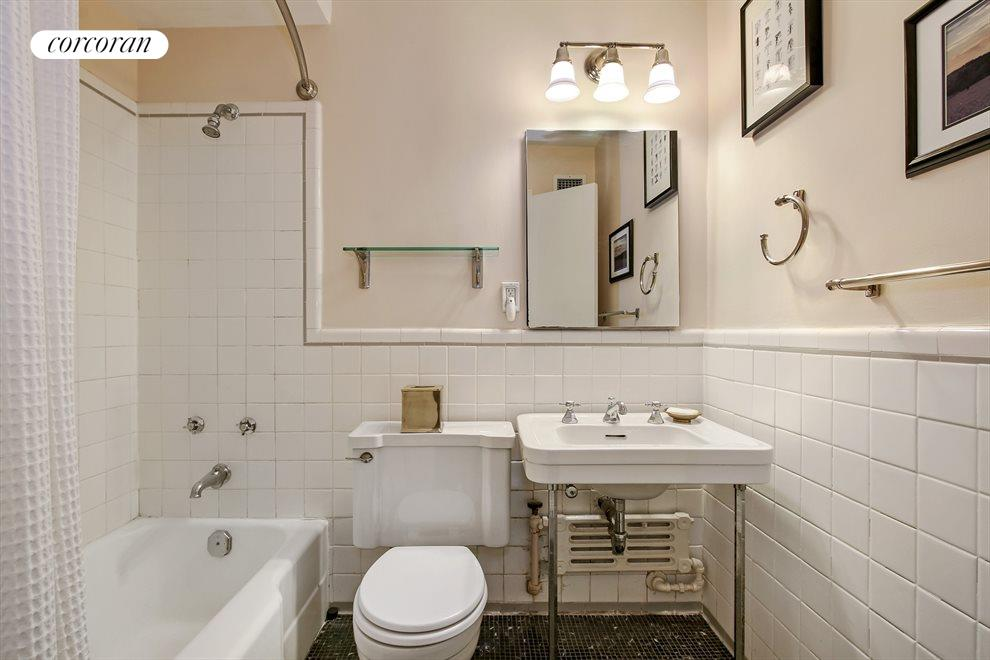 Brightly lit bathroom with lots of space