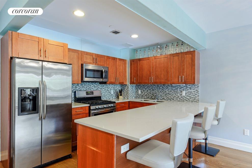 Custom frosted glass tile framing kitchen like art