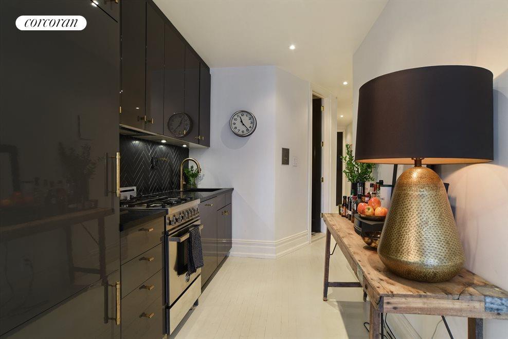Bespoke kitchen w/ honed herringbone black marble