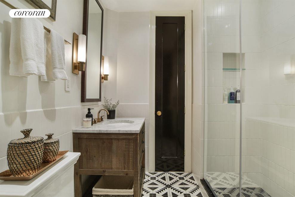 Spa like bath w/rain shower & striking tiles