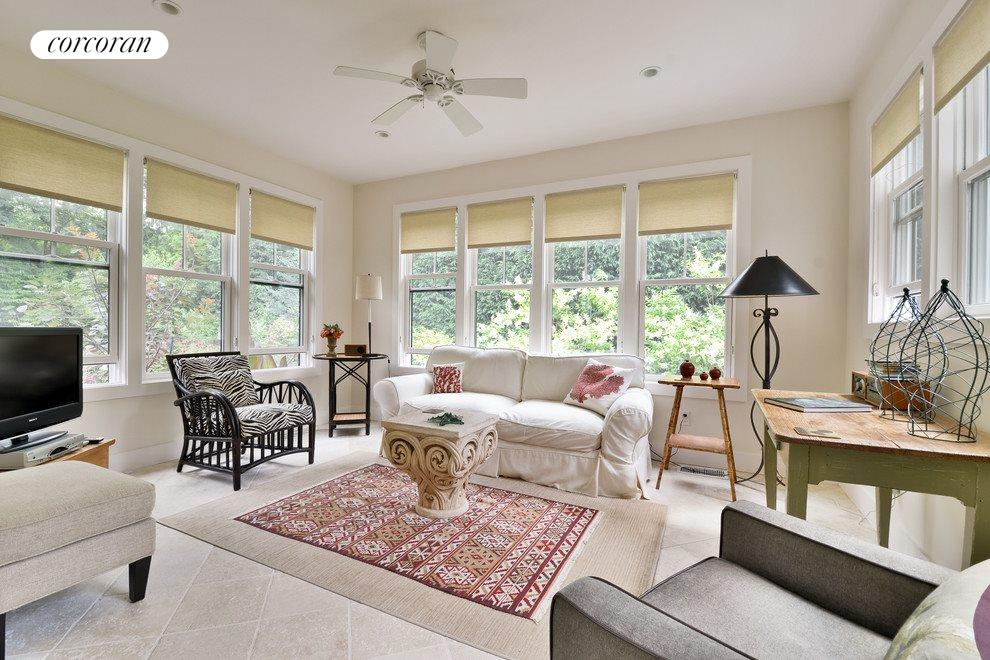 Sun room connects to the kitchen and the outdoors