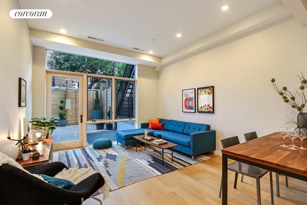 Open Living Room Flows to Garden