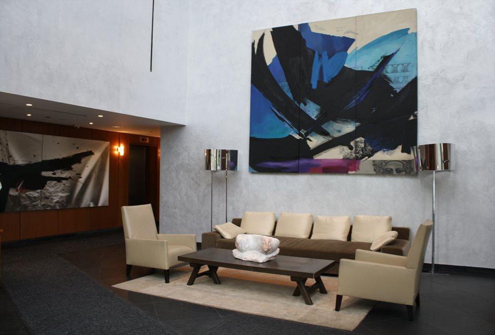 Elegant lobby with soaring triple height ceilings