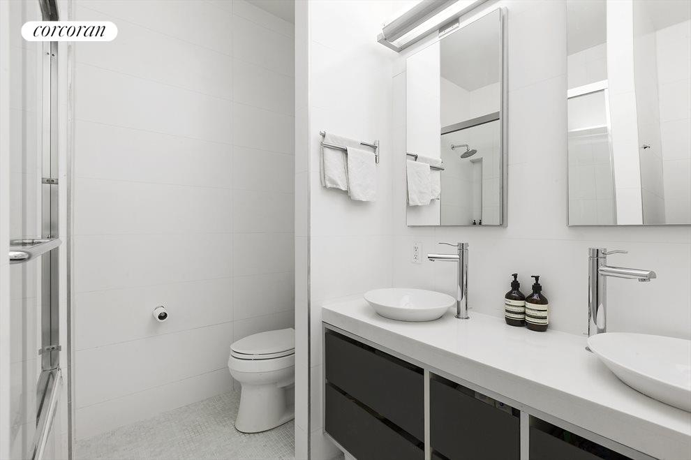 Tiled Bathroom w/ Double Vanity & Soaking Tub