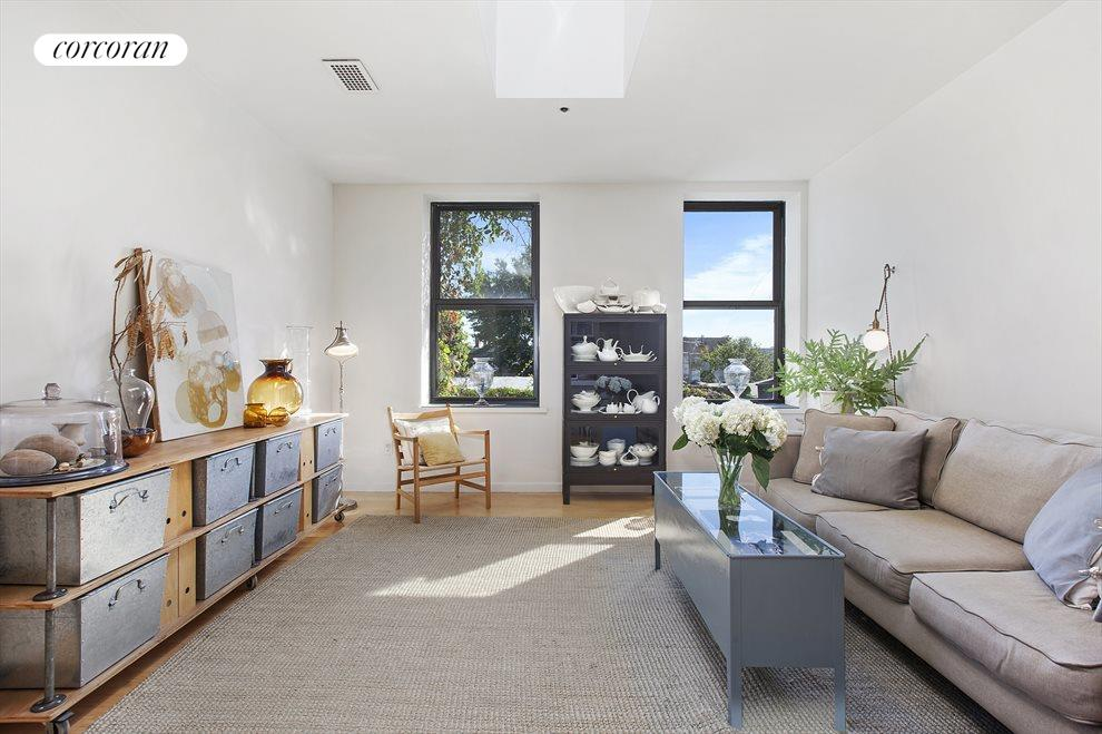 Expansive Living/Dining Room w/ Skylight